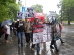 Manning supporters walk to the embassy of Ecuador
