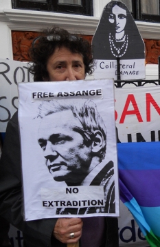 Clara with a placard in support of Assange