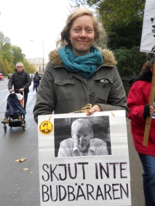 Swedish woman holds a sign in support of Assange